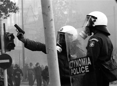 MAT policeman aiming at protesters during the Athens Riots (December 2008)